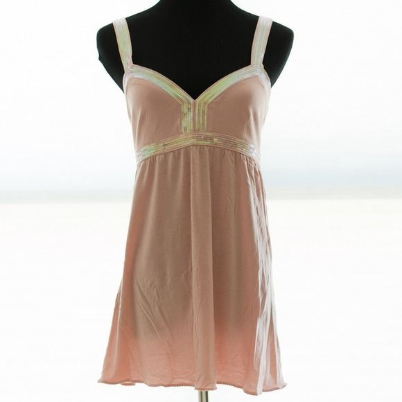 """*REDUCED FROM $15* EXPRESS iridescent sequin tank This pale peach-pink tank top is a bit more special than your typical tank. Its lyocell construction gives it a smooth, silky, uber-soft feel, and the rows of iridescent sequins dress it up. The roomy, flowing feel make this great for hot days, or accommodating a baby bump in comfort. A fav of mine. GOOD CONDITION; FABRIC DOES NOT SHOW SIGNS OF WEAR. 9 SEQUINS MISSING FROM BUST BAND, BUT NOT EASILY VISIBLE. Worn ~10 times. 29"""" length from…"""