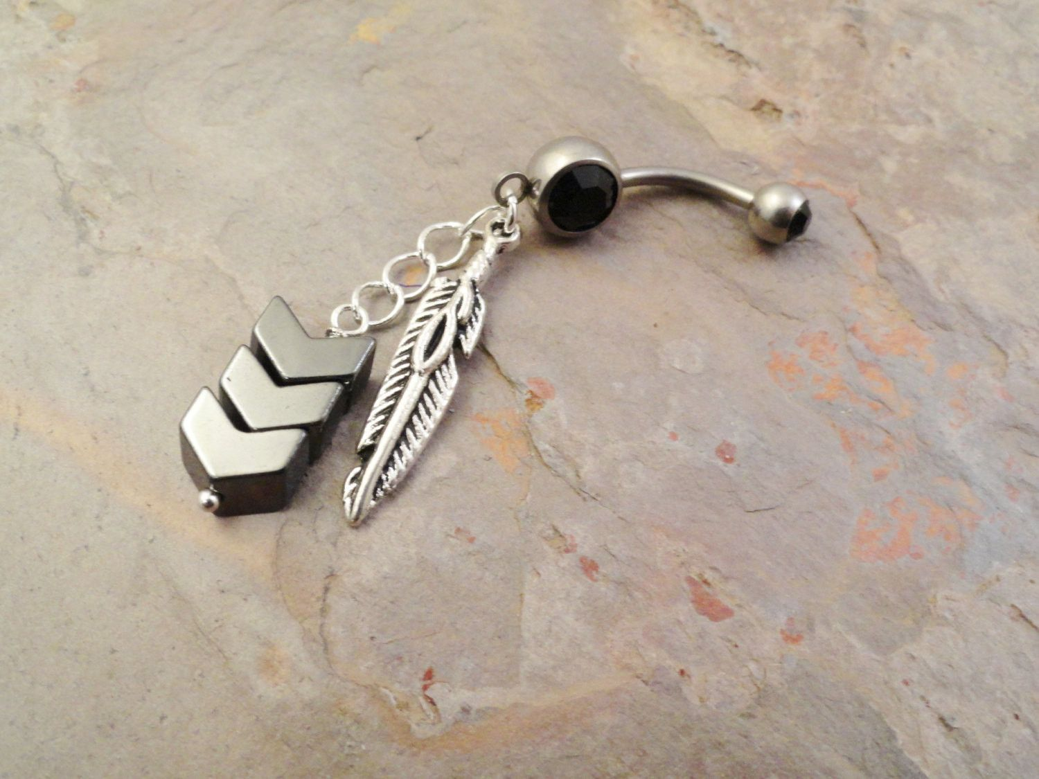Long belly piercing  Hematite chevron belly button ring with a tibetian silver feather