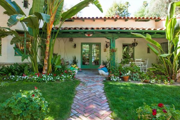 A look inside the colorful spanish style ranch annie potts for Hacienda ranch style homes