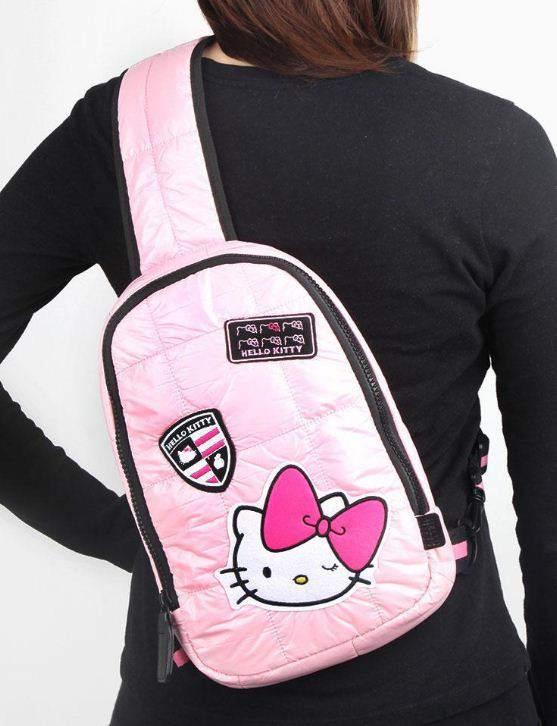 338d04695 This pretty pink #HelloKitty bag slings over the shoulder for girls on the  go!