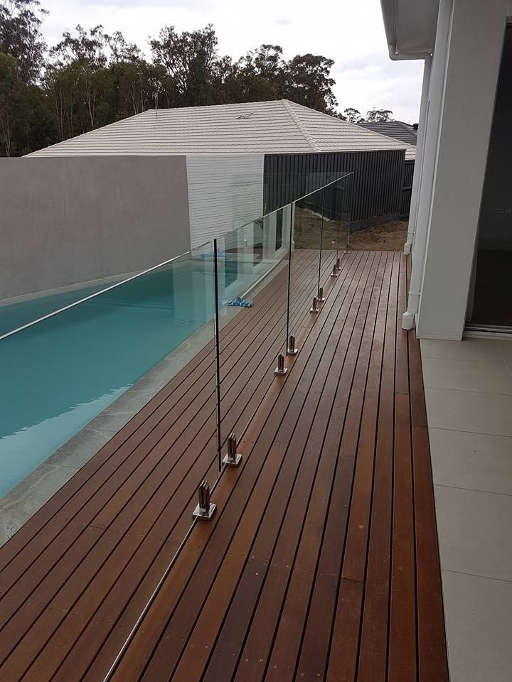 Noosa Merbau Decking With Frameless Pool Fencing Pool Fence Backyard Fences Fence Design