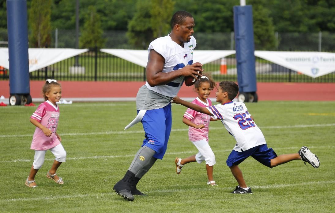 Nfl Players Share Tender Moments With Their Kids At Training Camp Nfl Players Football Training Training Camp