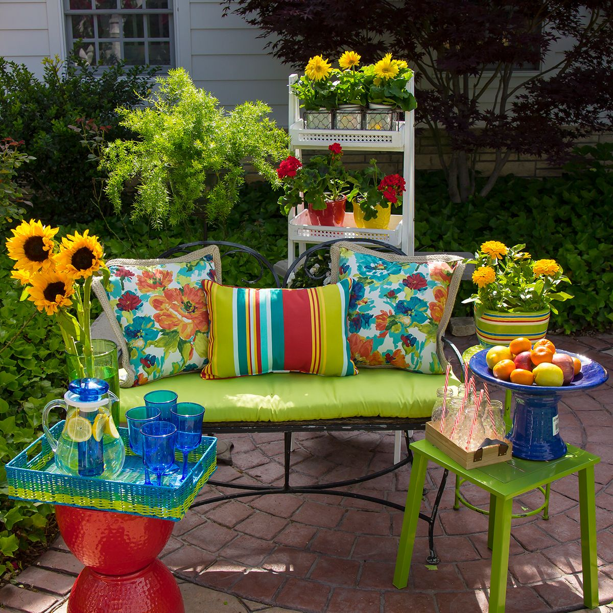 Bright-colored lime green patio cushions and stools are lively ...