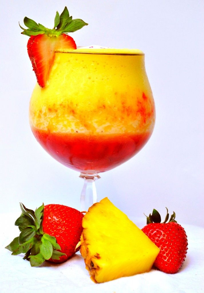 Pineapple Upside Down Cake Daiquiri -1 cup freshly frozen pineapple chunks, 2 large fresh strawberries, 2 splashes naturally sweetened pineapple-coconut or coconut sparkling water (Like La Croix), 2 handfuls crushed ice cubes, 1 oz whipped cream vodka, ½ oz pineapple rum.