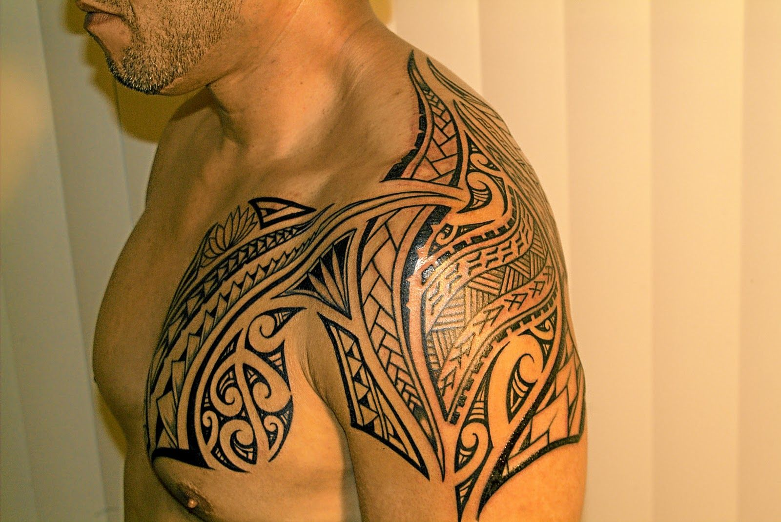 Polynesian tattoo on arm and chest - Polynesian Shoulder And Chest Tattoos Real Photo Pictures Images