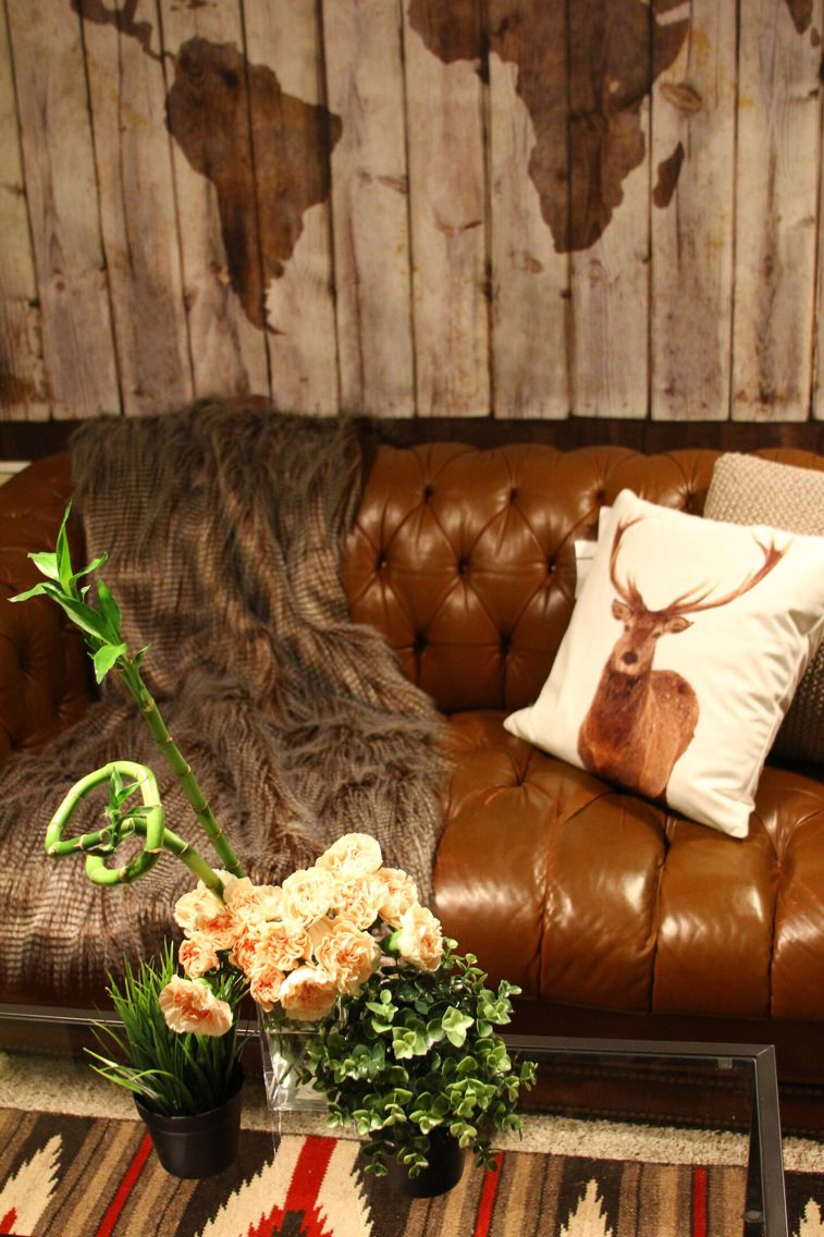 Staging project leather sofa traveling theme deer pillow fur