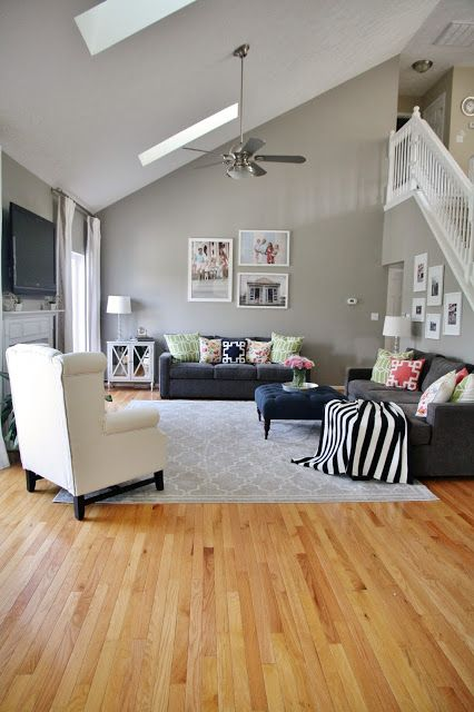 Gray Living Room With Pops Of Pattern And Color Gray Walls And Sofas Gray Area Rug Ligh Grey Walls Living Room Living Room Wood Floor Oak Floor Living Room