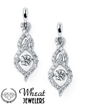 Fancy Twisting Shimmering Diamond Dangle Earrings Available At Wheat Jewelers