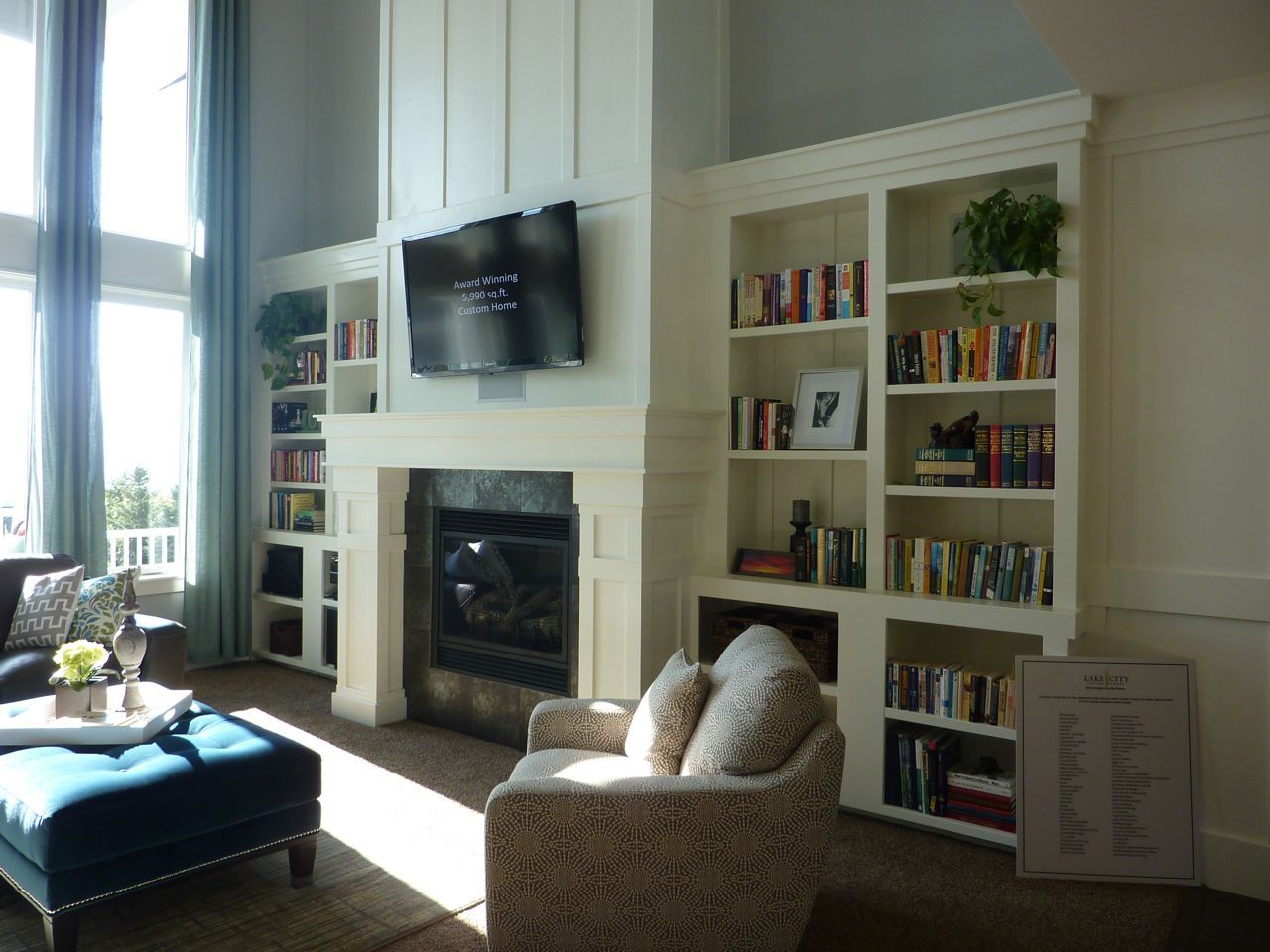 Fireplace fir 2 story great room. No tv above. Needs more ...