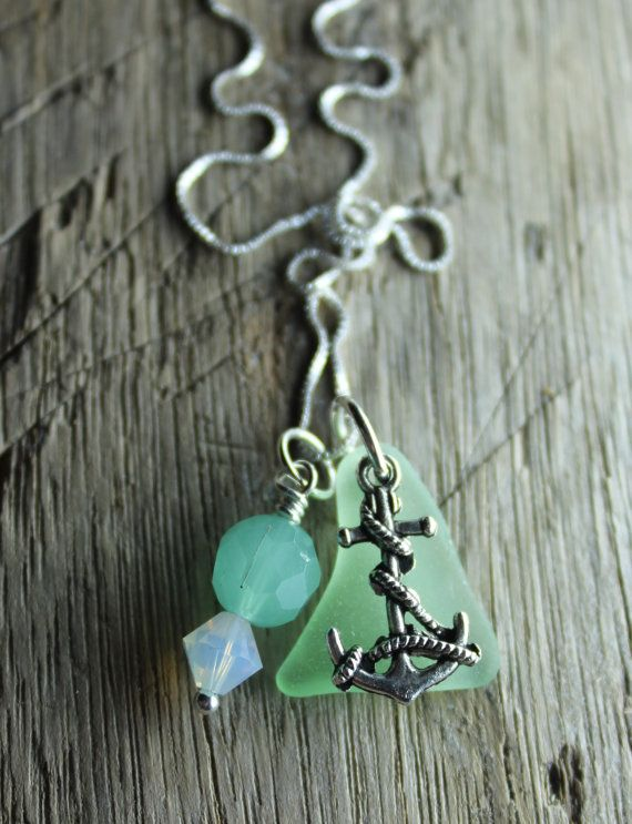 Lets go sailing!! A gorgeous cluster of summer colors! Lovely blue green genuine sea glass ~ IN THE SHAPE OF A SAIL ~ its topped by a stunning