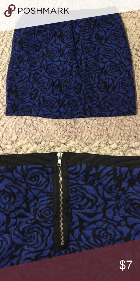 Blue Floral Skirt This blue floral skirt features an elastic waist and exposed back zipper. Unworn. Forever 21 Dresses