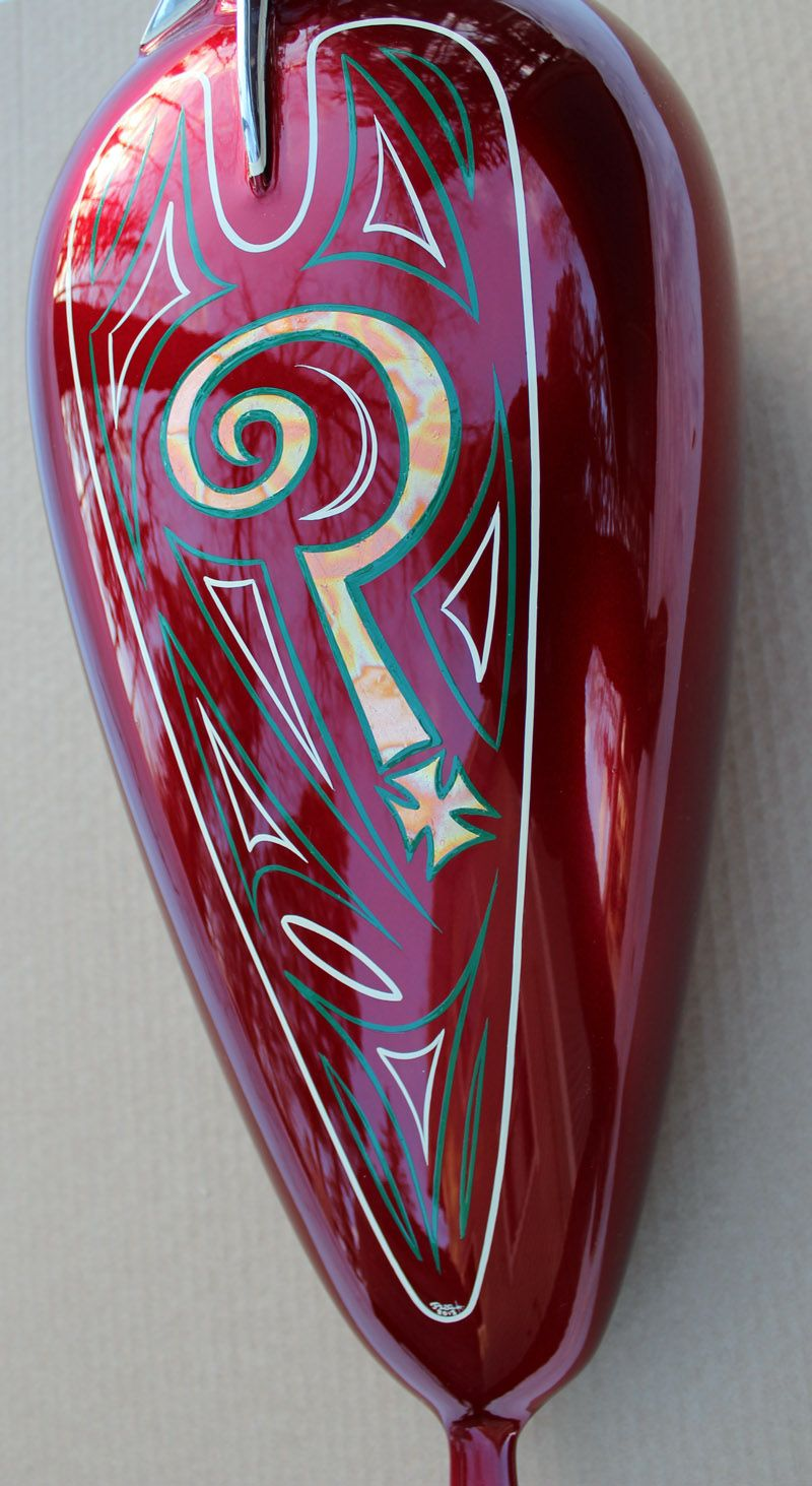 Indian Larry theme to the chopper tank. Custom paint
