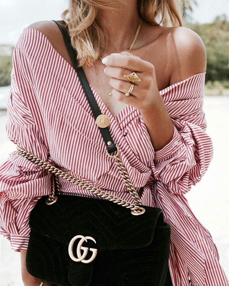 red and white off the shoulder top black velvet gucci bag