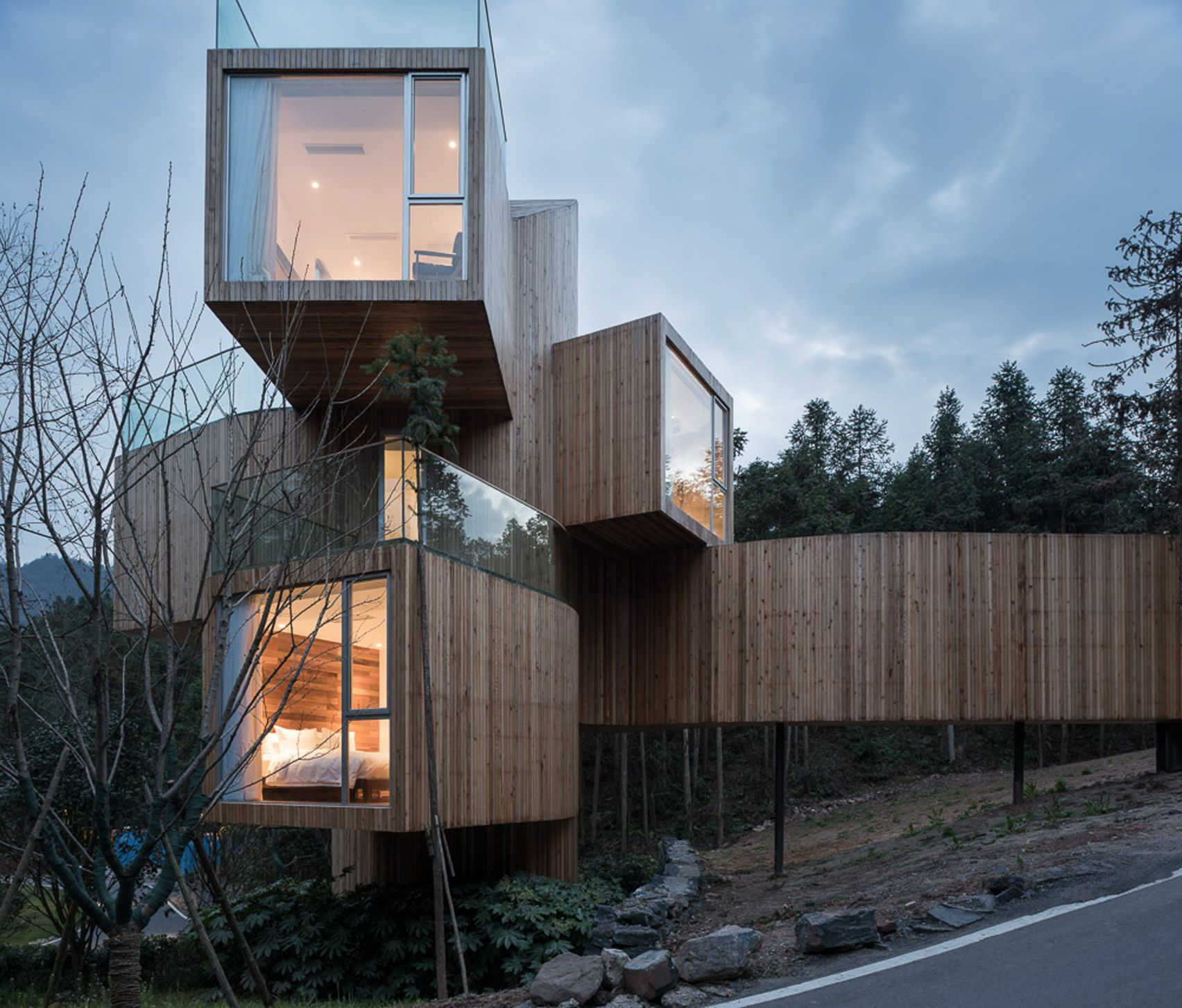 Stacked Boxes Form Bengo Studios Towering Tree House Hotel In