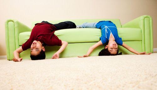 stretching on sofa