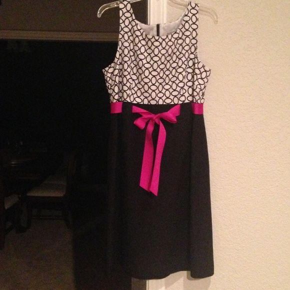 Party dress size 14 Black and white with hot pink sash tie.  Worn once to a wedding.  Super flattering and would fit size 12 too.  Would be cute holiday party dress as well. Jessica Howard Dresses