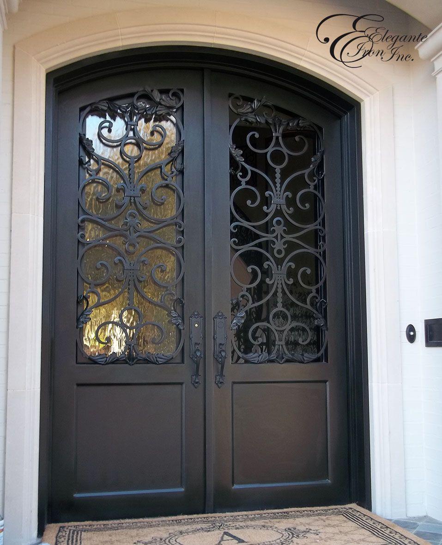 Custom Iron Door Shown With One Operable Glass Panel Open In 2020 Iron Doors Door Glass Design Craftsman Front Doors