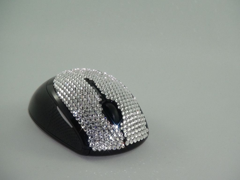 Microsoft Mobile Mouse 5000 Blingkled with hundreds of authentic Swarovski Elements crystals that dress this mouse only for brilliant knowledge workers.  Blingkle.net.