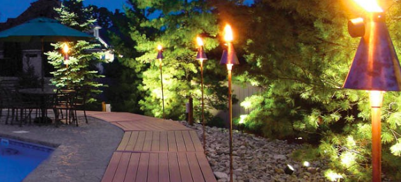 backyard deck with torches - Google Search