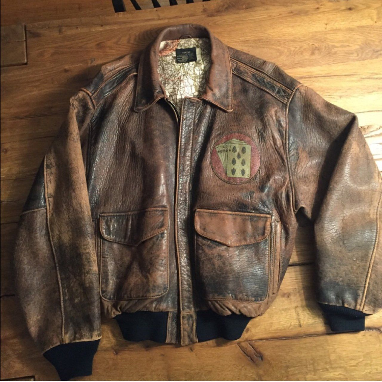 7e171b4cf49 Authentic Avirex LTD Flight Jacket. Vintage 80s. Type A-2. Sack Time pin up  across the back. Distressed brown leather. Snap down point collar.