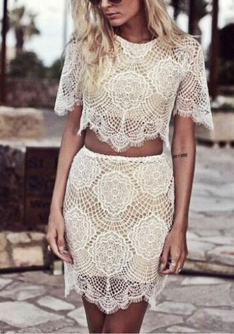 Angled shot of girl in white floral lace co-ord skirt set