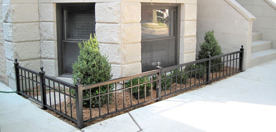 A small custom wrought iron garden fence fabrication and