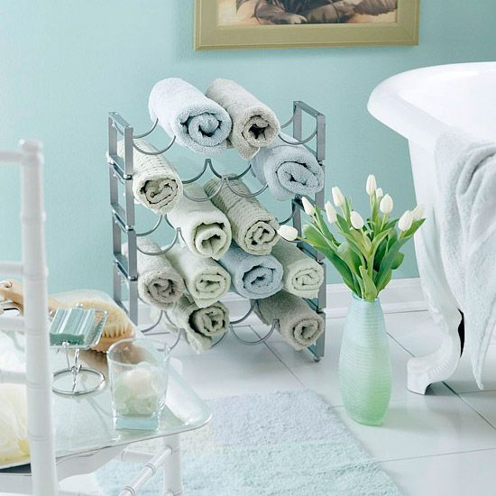 A wine rack makes a perfect storage place for rolled towels in the bathroom. Not only are the towels easy to reach, but they become instant decoration. So choose towels in multiple colors for a beautiful display.