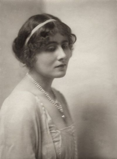Elizabeth Bowes-Lyon (1900 - 2002). Wife of George VI. Queen from 1936 - 1952. Mother of Elizabeth II and Princess Margaret. Adolf Hitler called the most dangerous woman in Europe because of her ability to boost British morale. She was always extremely popular, even when the rest of the royal family were disliked by the public. She died aged 101 in 2002.: