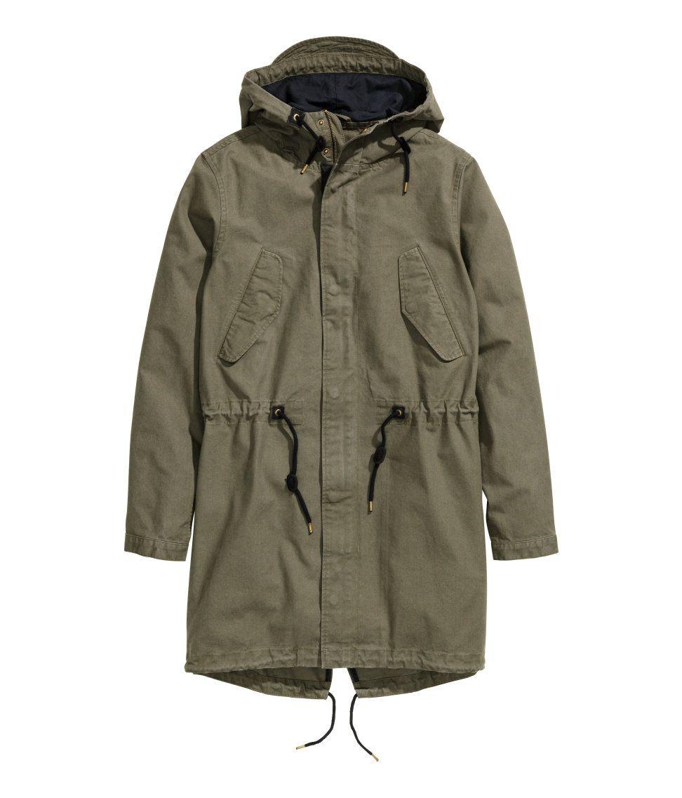 0b2877975 Khaki green parka with hood visor, drawstring waist, and wind flap ...