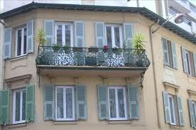 Wrought-iron faux balcony and shutters