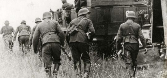 """After the Battle of Smolensk, German soldiers take new positions. The vehicle have a white """"G"""" painted on the rear meaning that it belongs to Panzergruppe Guderian. When German forces reached Smolensk they stood a mere 230 miles (368 km) from the greatest prize of them all — Moscow. Photo: August 2, 1941."""