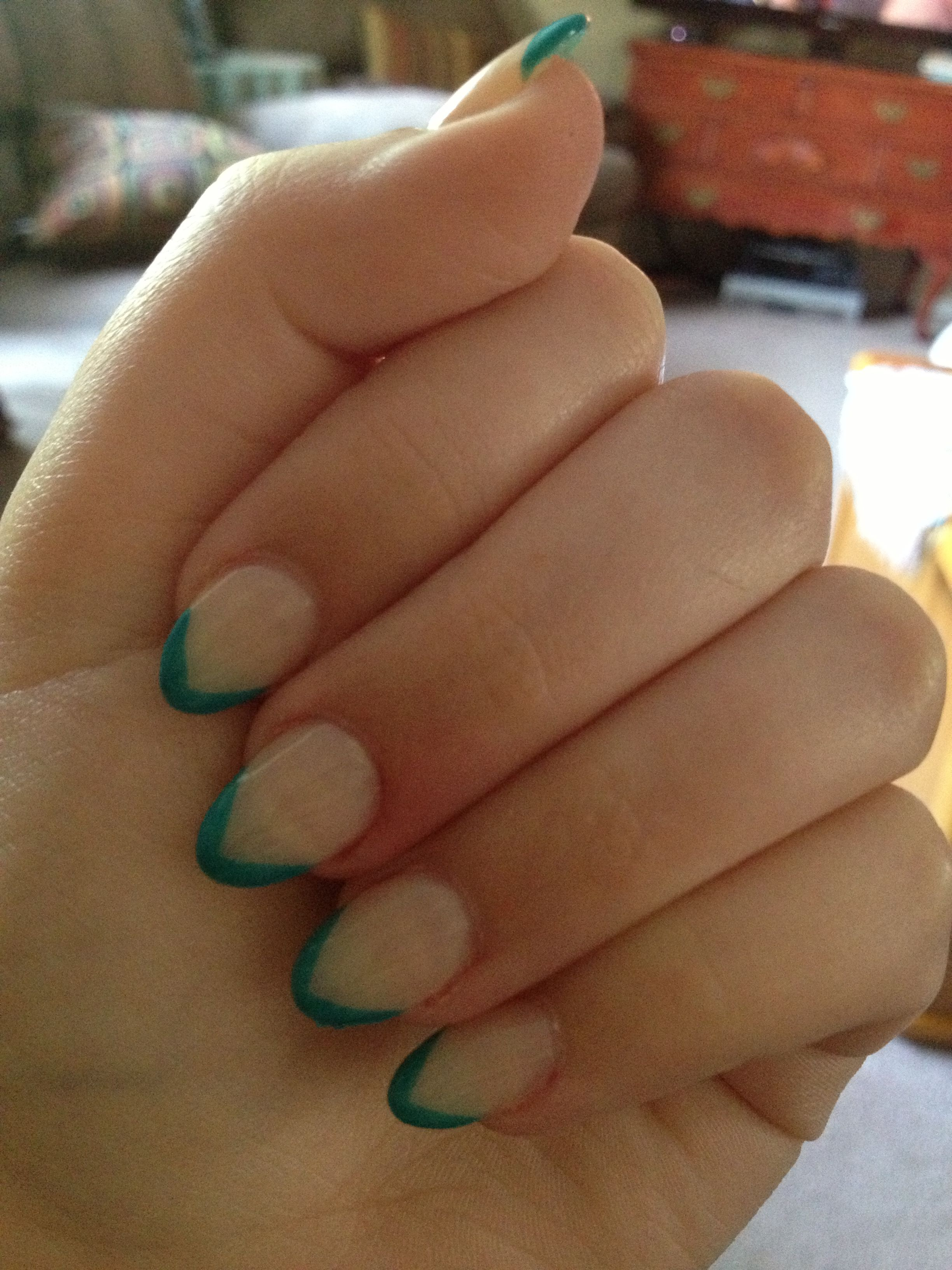 Almond shaped nails with teal v-shaped tips and nude base. Love this ...
