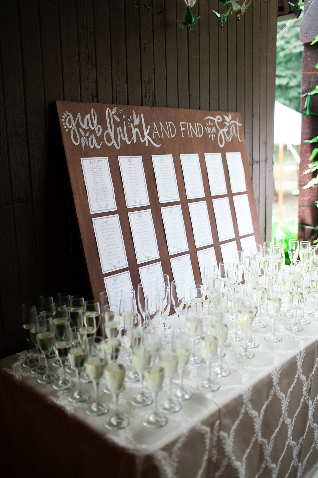 table with champagne and seating chart Wedding