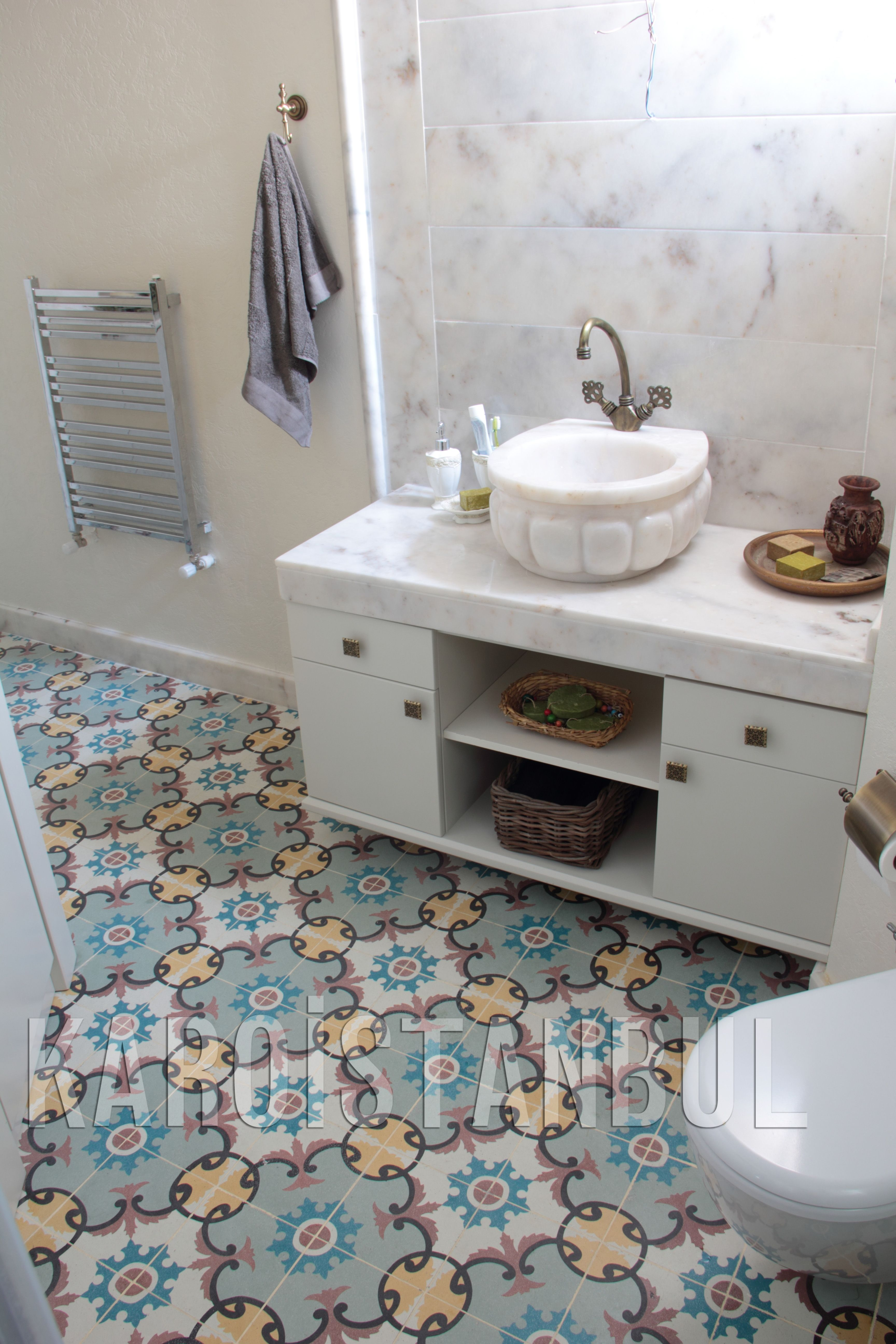 The karoistanbul tiles are entirely handmade they are composed of colorful encaustic tiles nicely set off the cool marble splashback in this neat bathroom dailygadgetfo Images