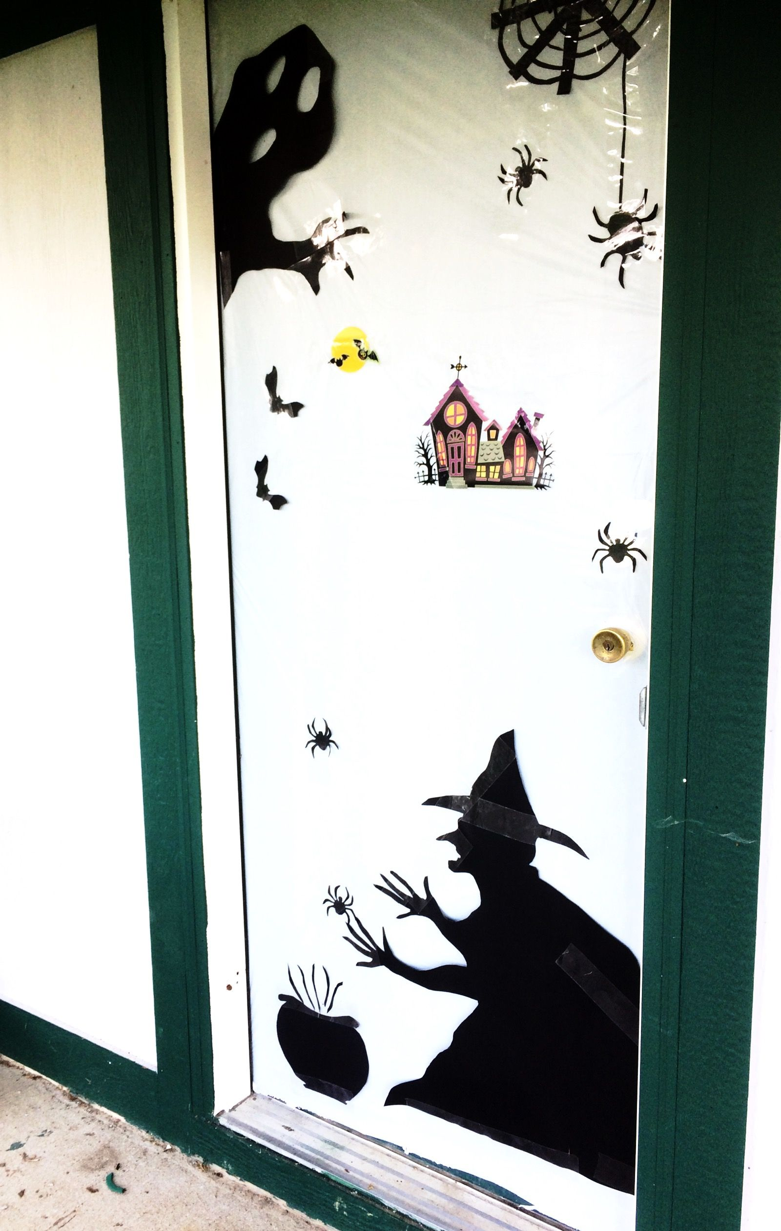 Easy Halloween door decoration diy with tablecloth and black poster - Halloween Door Decorations