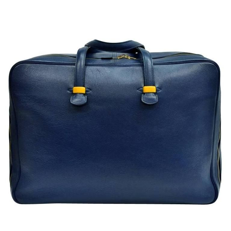 Large Leather Traveling Bag by Hermès | From a unique collection of antique and modern trunks and luggage at https://www.1stdibs.com/furniture/more-furniture-collectibles/trunks-luggage/