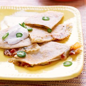 Texas Quesadillas- Fresh cilantro and zippy chile peppers add punches of flavor to this Texas-style favorite comfort food. Light sour cream helps keep the fat and calories low, but you won't notice.