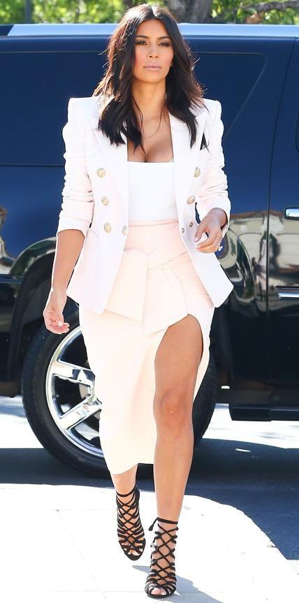 b1daa94032ce Kim Kardashian Debuts Her North West–Painted Handbag
