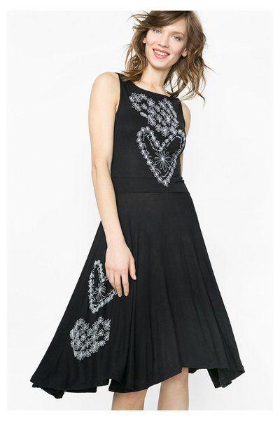 cc34a06dd Vestido con falda asimétrica y plisada Desigual. ¡Descubre la colección  primavera-verano 2016!