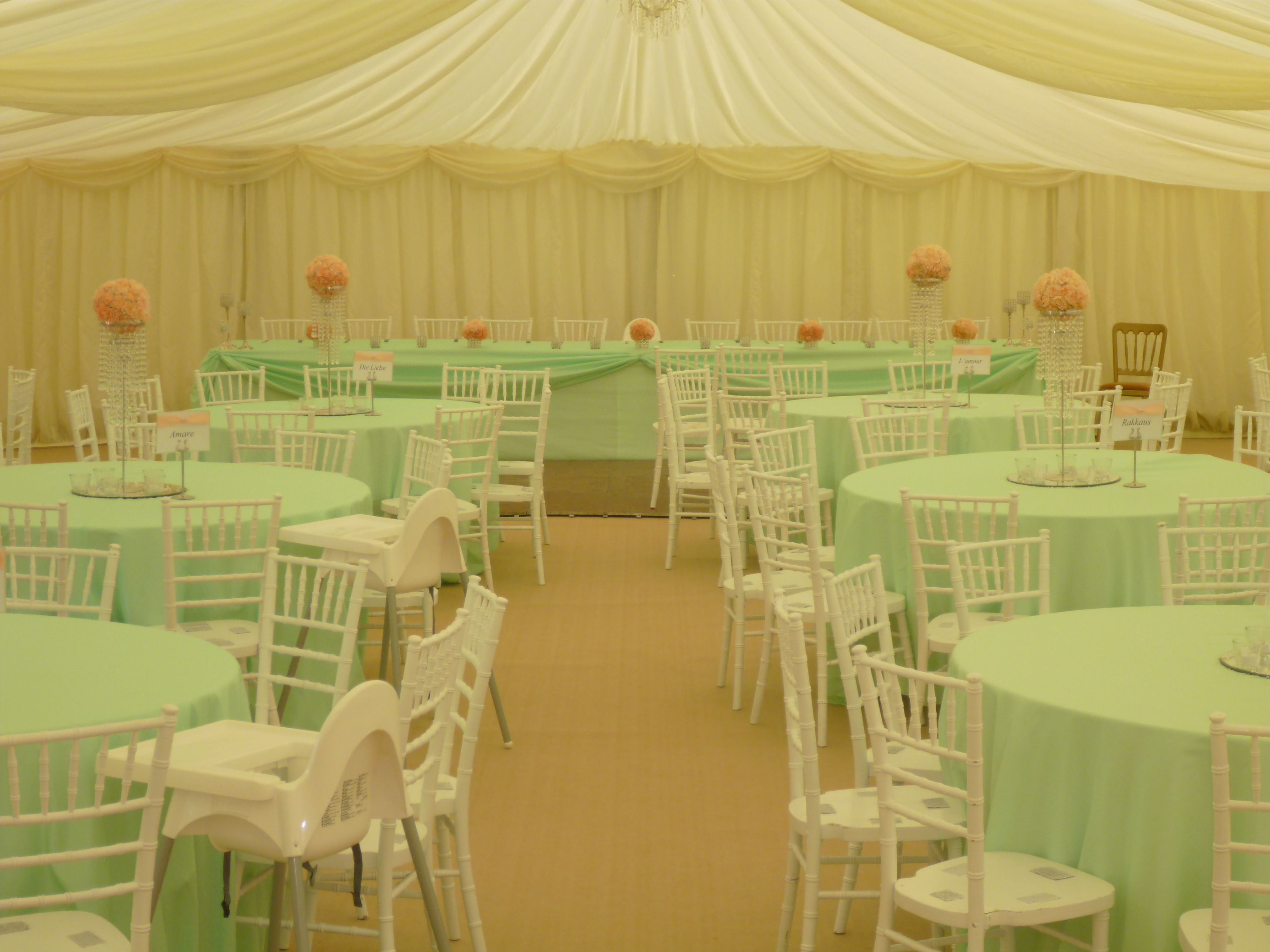 Mint table cloths with peach flowers and chiviari chairs
