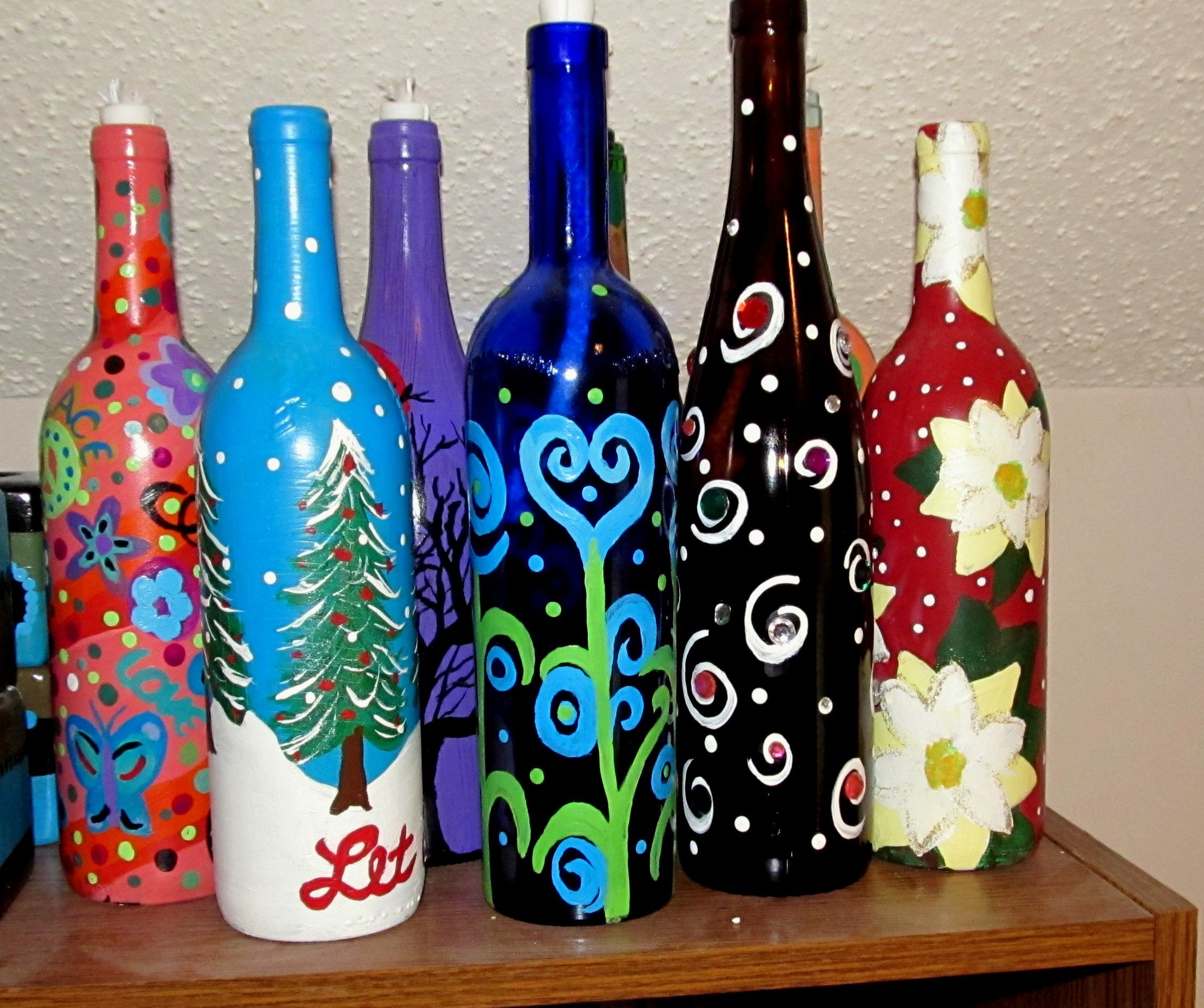 Hand painted wine bottle oil lamps hand painted for Painting flowers on wine bottles