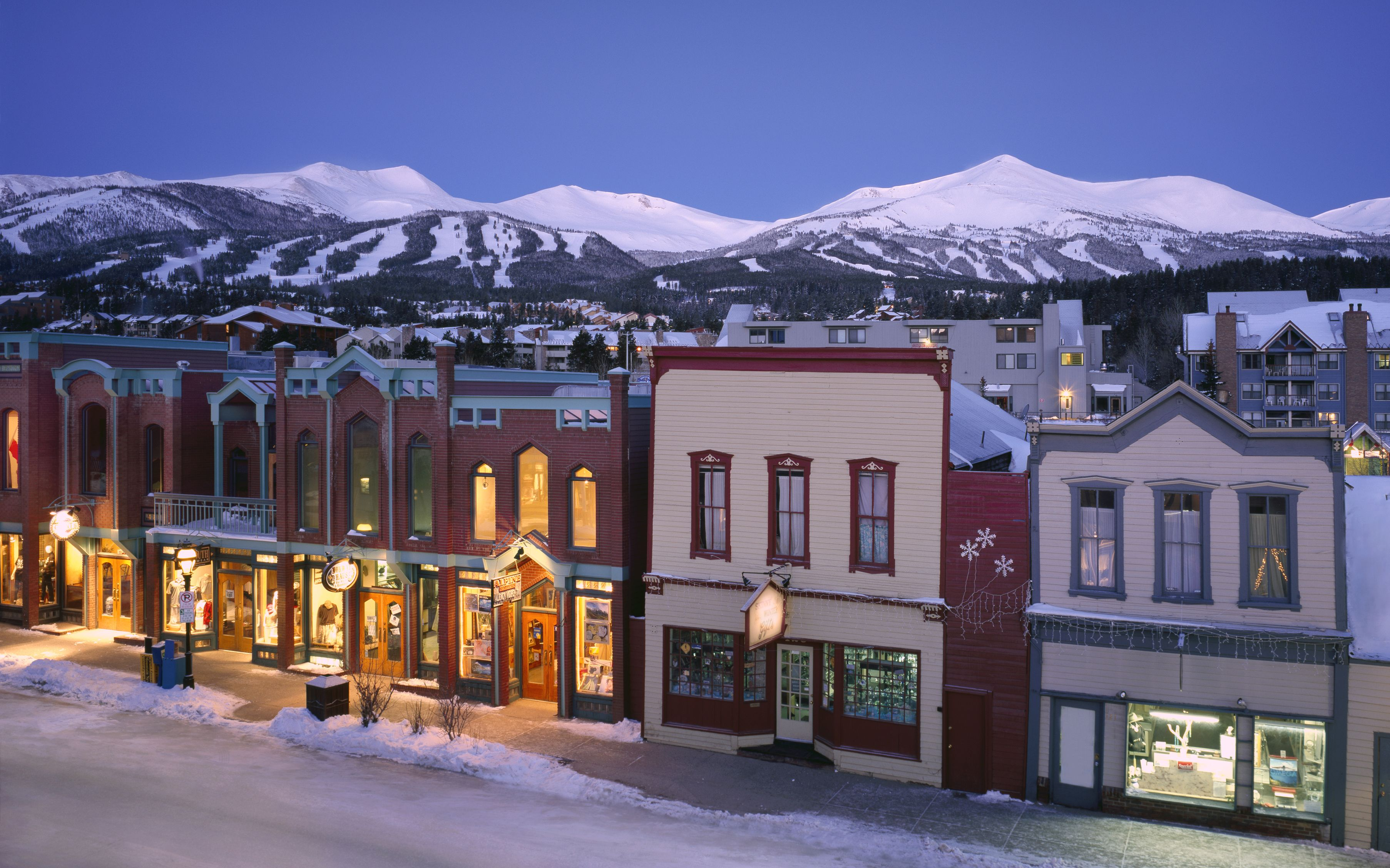 the town of breckenridge sits sweetly under the resort one evening
