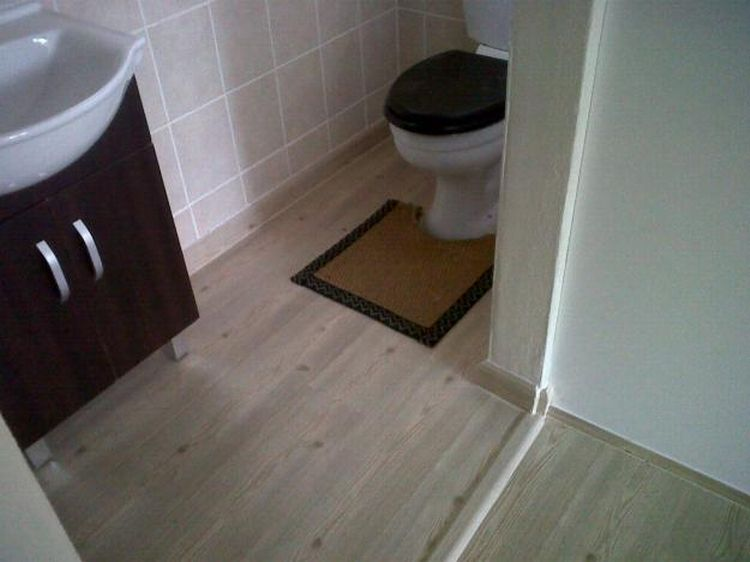 Simple contemporary bathroom with rubber laminate flooring for Rubber laminate flooring