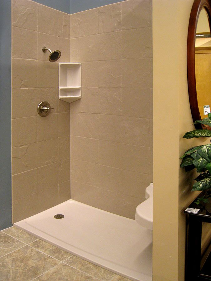 Solid Surface Walls With A Stone Tile Finish Low Threshold Base And Corner Caddy Fiberglass Shower Bathroom Remodel Shower