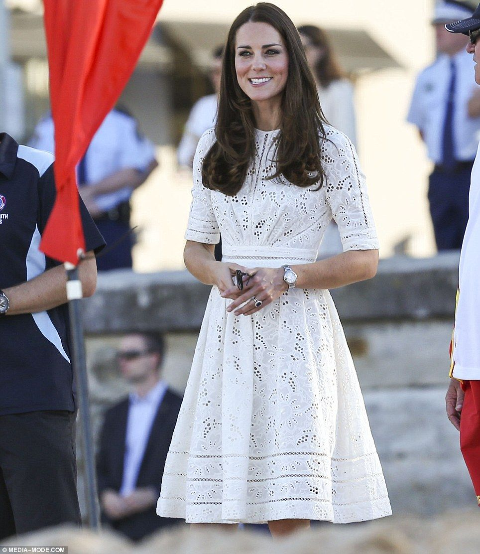 All white: Kate was still wearing the sundress by Australian designer Zimmerman she wore earlier in the day for a visit to the Royal Easter Show