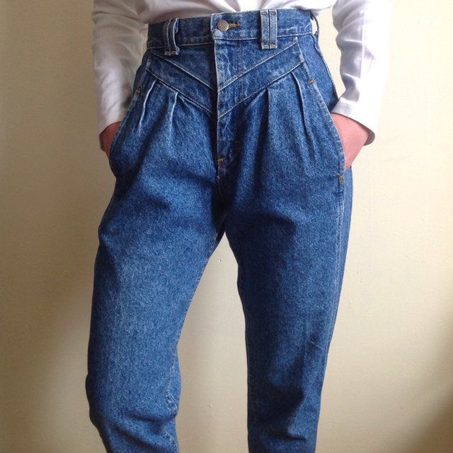 e7e9fecd These jeans have a pleated front with panels across the stomach. They have  tapered legs going down to a slim ankle. Classic vintage 1980s. High Waist  No ...