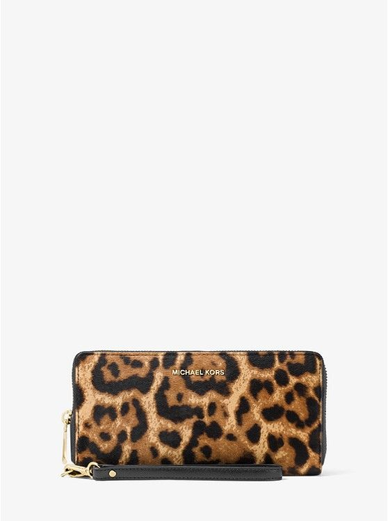 34021141bf2d Jet Set Travel Leopard Calf Hair Continental Wristlet  preview0 Michael  Kors Jet Set