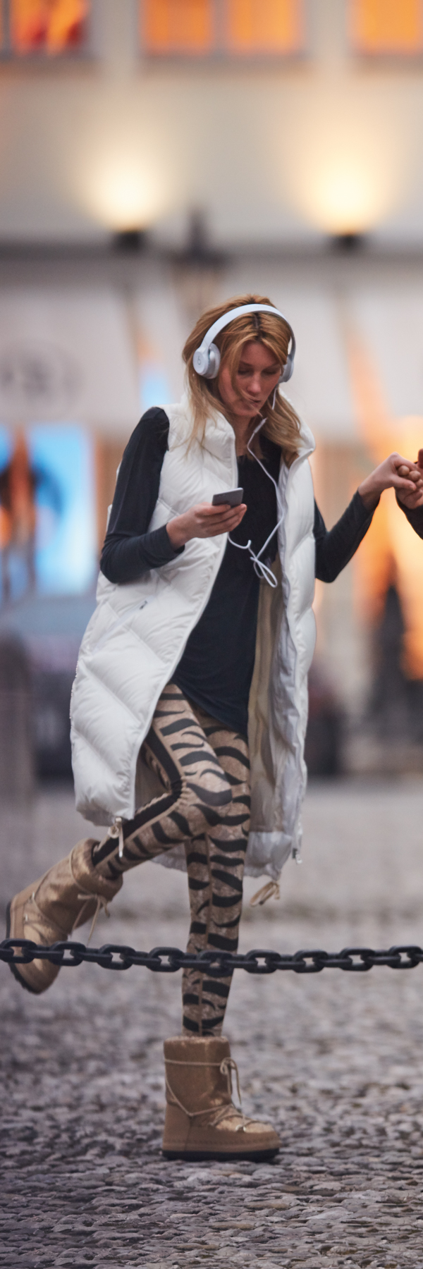 Glamour on the go is not an oxymoron: the new athleisure collection from Bogner Sport is elegant enough to wear to the club and comfortable and functional enough to wear to the gym. Glittering gold, tiger-striped leggings are just the start. Just throw on this luxurious long down vest and get on your way!