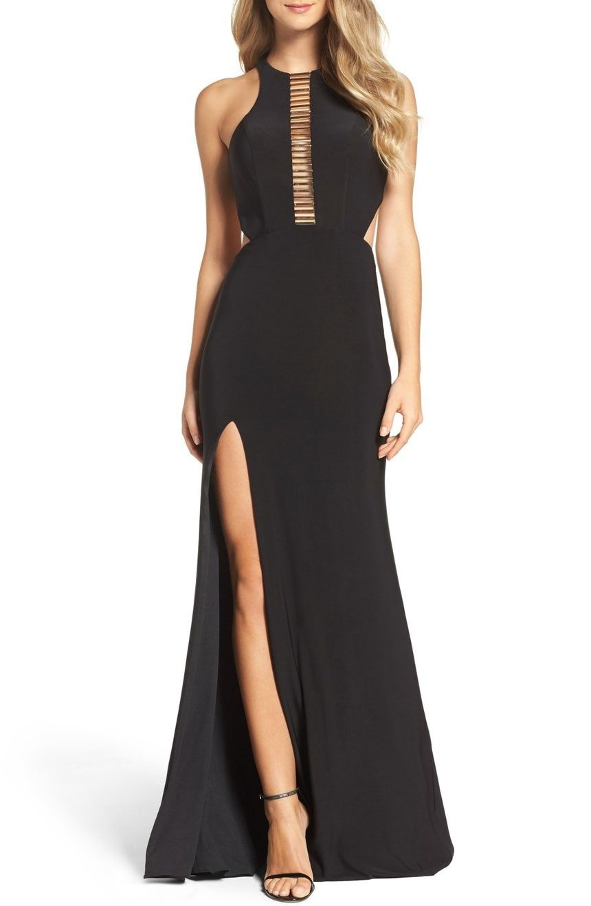 Stun in this slinky evening gown that reveals some skin with a ...
