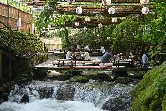 Kawadoko is the ingenious custom of dining on platforms built over a river which provides natural air conditioning during the hot summer months. We experienced kawadoko in Kibune, a small town in a valley just north of central Kyoto in early July.